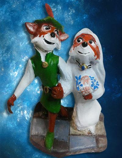 Cake topper di terracotta, raffigurante i cartoni animati Robin hood e Lady Marian sposi. Fatto a mano