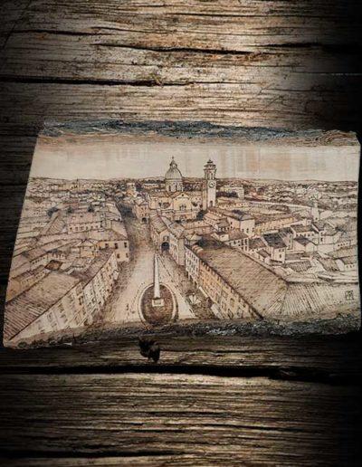 Incisione su legno di olivo a pirografo di una vista Reggio Emilia