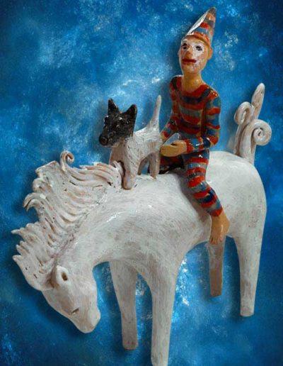 Statuina di circense e cagnolino a cavallo