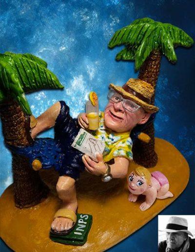 Statuina di terracotta di uomo sdraiato su un amaca fra due palme con un bicchiere da aperitivo in mano, e una settimana enignimistica nell'altra. Appoggia il piede su un plico dell'inps e ha un bebè femmina vicino a lui che gattona. Fatto a mano.