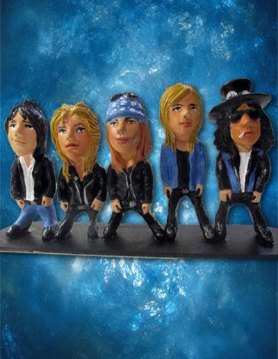 4 statuine di terracotta del gruppo musicale dei Guns N' Roses, caricaturate.Fatto a mano in stile statuine di Napoli