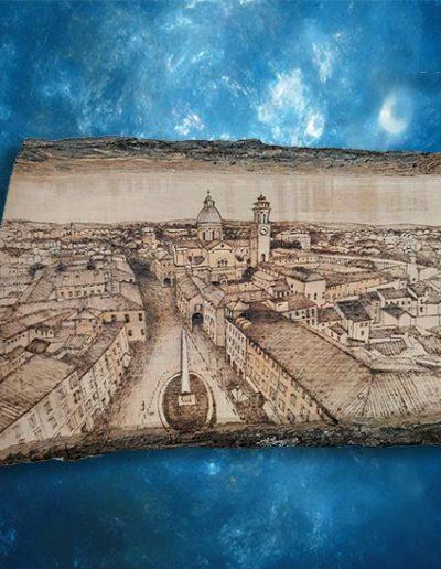 Disegno a pirografo su tavola d'olivo raffigurante una veduta di Reggio Emilia