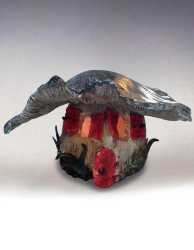 Manufatto realizzato da allievo di corso ceramica, trattasi di un portalumino a forma di fungo