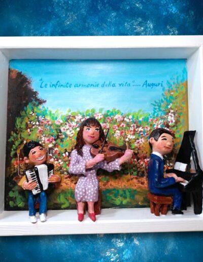 Quadretto in terracotta con tre giovani musicisti